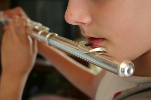 Child playing a traverse flute