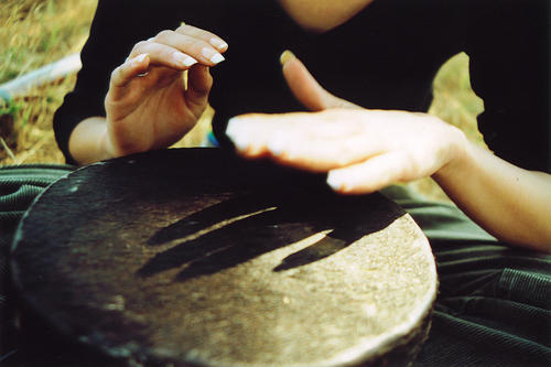 hands playing on African drum
