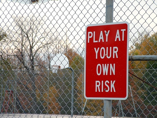 playground sign: Play at your own risk