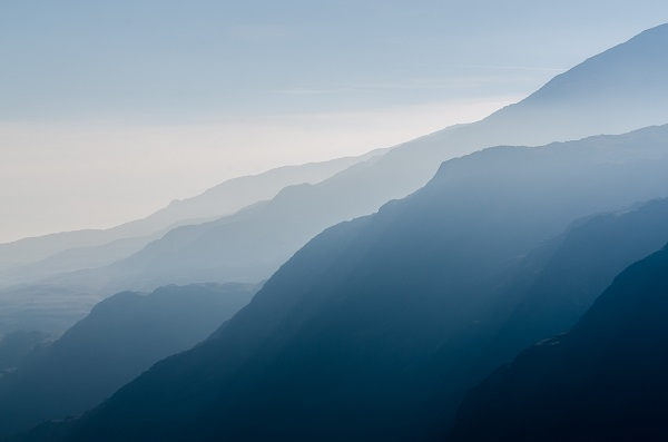 Mountains, each in different shade of blue