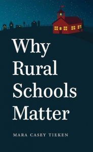 Cover of Why Rural Schools Matter shows small school lit at night in dark surroundings