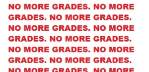 """The phrase """"No More Grades"""" is repeated numerous times in red letters on a white background."""