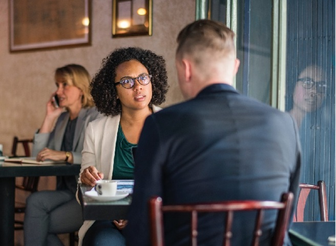 couple in cafe having respectful argument
