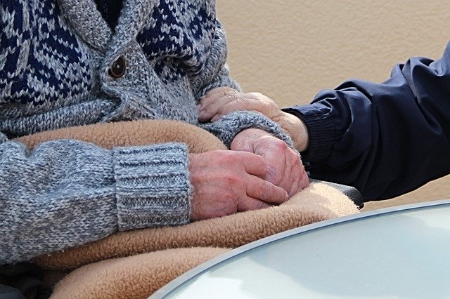 hands of two elderly persons